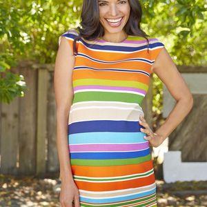 Mom in Orange Striped Dress Smiling Full Body Shot