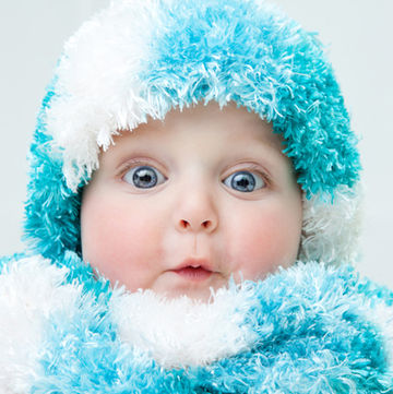 baby dressed in cool blue hat and scarf