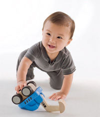 boy playing with truck article_0.jpg