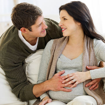 Pregnant-Couple-Looking-at-Each-Other_700x700_corbis-42-33809146.jpg