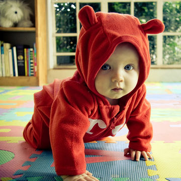 Baby crawling in playroom