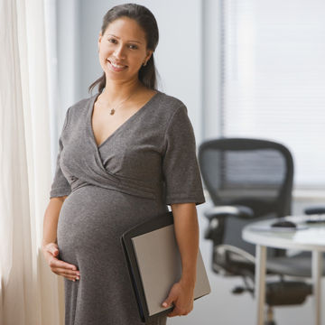 Woman working while pregnant