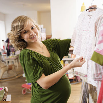 young-pregnant-woman-shopping-baby-clothing_700x700_Corbis-42-34358403.jpg