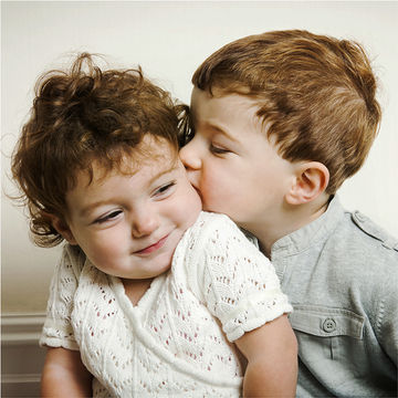 young siblings hugging