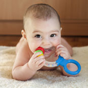 baby teething on a toy