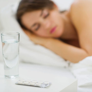 Woman with sleeping pills