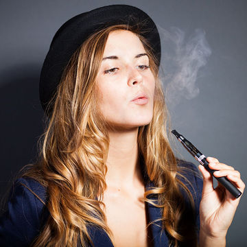 Woman smoking an e-cigarette