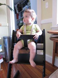 tucker in stokke chair article.jpg