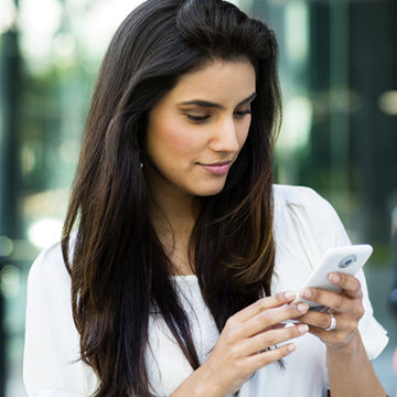 youn-woman-using-app-on-her-smartphone_CorbisImage-42-46565242.jpg