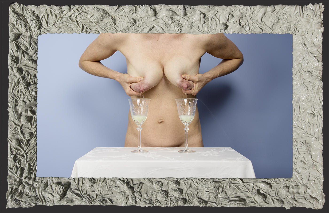 Asya Reznikov expresses breast milk into wine glasses for latest video project.