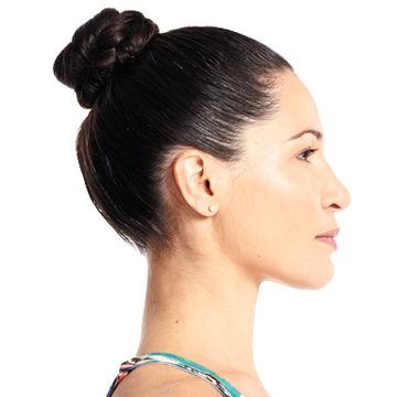 woman with black hair in a bun