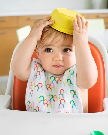 Baby on Highchair with Bowl on Head