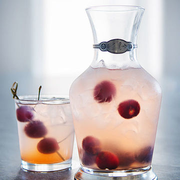 Easy Mocktails for Two Cherry Bomb Pitcher and Glass with Cherries