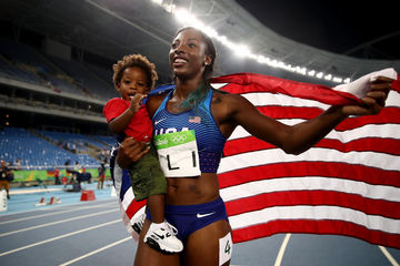 Nia Ali and son Titus at Olympics