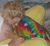 Charlie kissing belly main_198w.jpg
