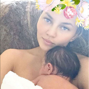 Chrissy Teigen with daughter Luna Simone under Snapchat Filter