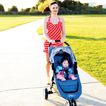 woman-walking-oustide-stroller-baby