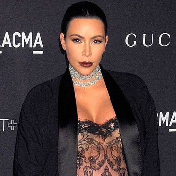 Pregnant Kim Kardashian Wears See-Through Suit