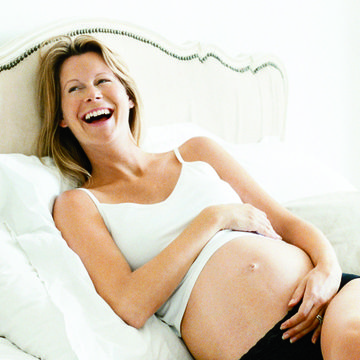Happy pregnant woman smiling