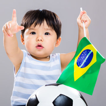baby with soccer ball and Brazilian flag for the World Cup