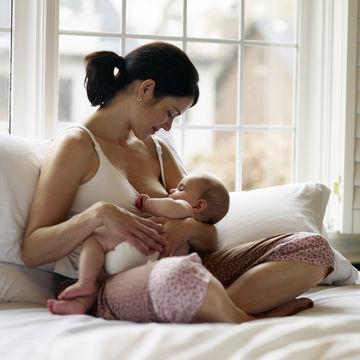 Image result for infant nursing at her breast
