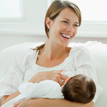 happy woman breastfeeding her baby