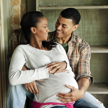 pregnant-couple-hugging_700x700_corbis-42-51494453.jpg