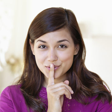 woman saying shhh