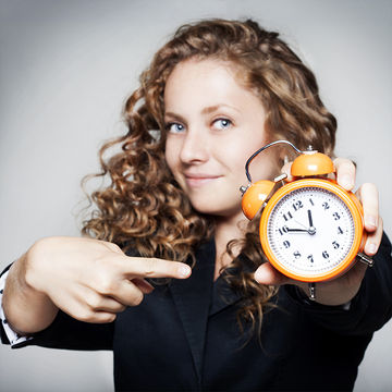 woman-pointing-to-clock_700x700.jpg