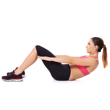young woman doing abdominal exercises