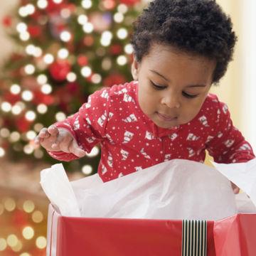 little-boy-peeking-into-gift-box_700x700_Getty-90603760.jpg