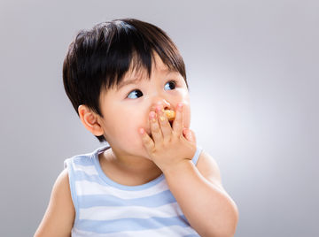 Cute baby eating snack food