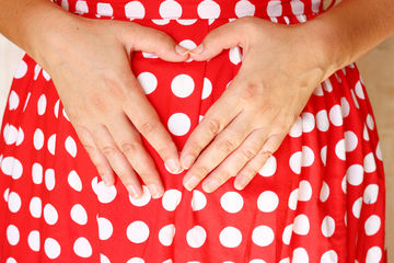 Pregnant Woman Covering Her Belly