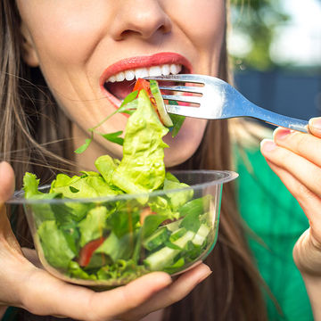 Woman Eats a Healthy Salad