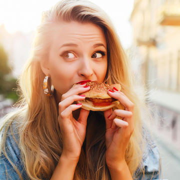 Blond Woman Unsure About Eating Fast Food