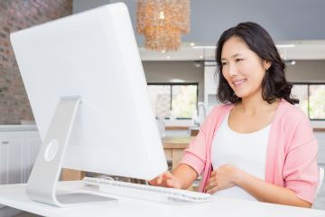 Pregnant Woman on Computer
