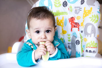 Baby eating first foods