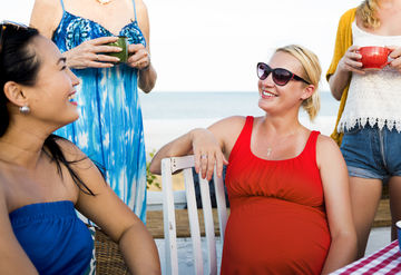Pregnant Woman With Friends