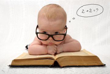 smart baby reading a math book
