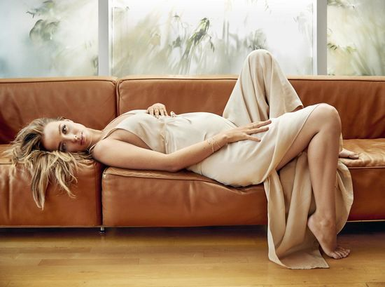 Camilla Luddington in Draped Beige Dress Laying Down on Couch