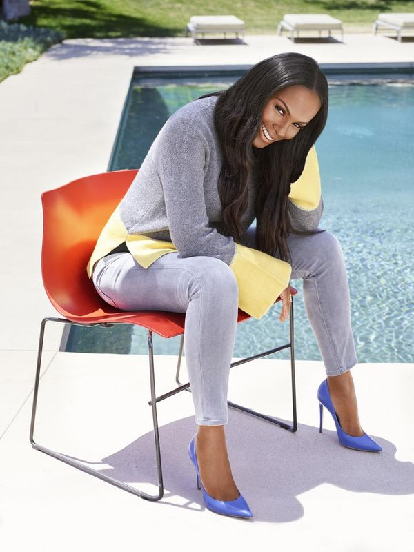 Tika Sumpter Sitting in Chair by Pool